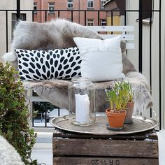 Terraces and balconies can have style too. Dramatic throw. Patterned pillow. Foliage. Contrasting elements. Texture. www.16Mdenver.com #16MResidences