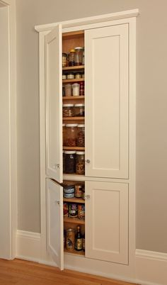 Ingenious pantry carved out between wall studs.