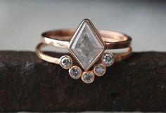 Natural grey diamonds in rose gold settings.