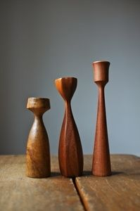 3 teak wood sculpted candle holders