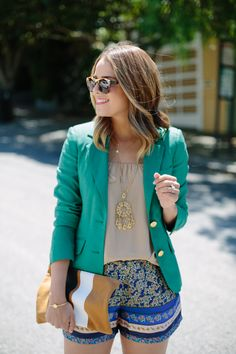 printed shorts, blazer and a Clare Vivier clutch
