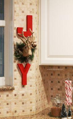 DIY | Adorable JOY Christmas wall decor. Cute way to dress up your kitchen. Click through for cute Christmas kitchen decor ideas.