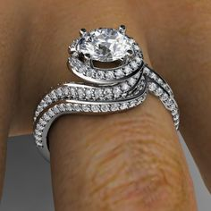 "Platinum diamond ""swirl"" engagement ring with matching ""swirl"" diamond wedding band"