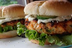 These GRILLED SALMON BURGERS may end up being the best burgers you ever make. Imagine chopped fresh Atlantic salmon mixed together with ginger, scallions, sesame and jalapeno - grilled to perfection - topped with an amazing wasabi, ginger mayo. Salmon Burgers Canned, Healthy Salmon Burgers, Beef Burgers, Seafood Burger Recipe, Seafood Recipes, Pan Seared Salmon, Grilled Salmon, Grilled Fish, Ginger Salmon