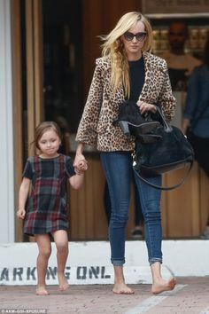 Kimberly Stewart Holds Daughter Delilahs Hand