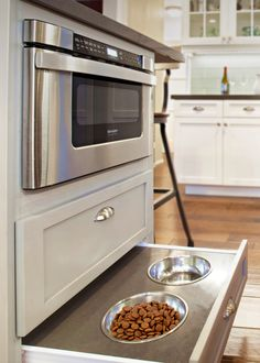 Built-in dog bowl drawer underneath the microwave drawer makes for easy access with out taking up room.