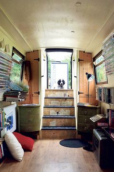 Interior of the Book Barge, which travels the canals of England, stopping to sell (and barter) its books and host author talks. Living On A Boat, Tiny Living, Canal Boat Interior, Canal Barge, Narrowboat Interiors, Dutch Barge, Houseboat Living, Floating House, Boat Stuff