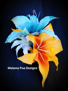 For the Tropical Princess in You! DOUBLE TURQUOISE/BLUE and Orange LILY Hair Clip with White Tahitian Spider Lily and Tropical Greenery. Unique, Exotic, Dramatic and one of a kind. Designed to wear as a graceful Hula dancer, Beach Bride, or Island Princess would wear. These custom
