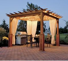 Pergola with curtains and lights. This is perfect!! Now to find curtains and break out the Christmas lights!!!