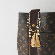 Looks good for brand bag with orange tassel charm. #orangetassel #bagcharm #オレンジタッセルチャーム