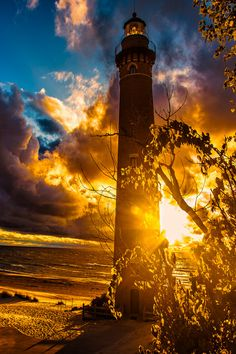 Lighthouse at Sunset near Silver Lake, Michigan, Photo by Tom Rogula!