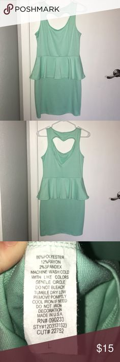 "Mint green body con mini with peplum detail Mint green, body con, mini dress with peplum detail at waist. Heart cut out in back. Dress measures 34"" from shoulder to hem. Never worn. Kirra Dresses Mini"