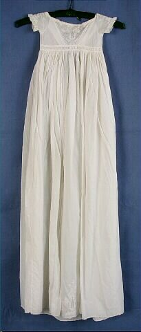 Dress, baby's, white cotton lawn, white work embroidery on sleeves, bodice and skirt, c. 1860