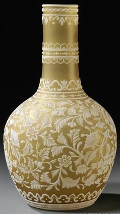 A Cameo glass vase in the manner of Webb, England, long neck on bulbous base with wheel-cut floral and vine decoration accented by geometric border at neck. Made in France, circa 1901-1925