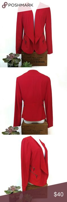 """Skye's The Limit Red Side Zip Open Blazer EUC. Worn once.   Size 6. 24"""" sleeves, 22"""" ling in back, 26"""" longest in front, 18"""" pit to pit flat, 17"""" waist flat, 16"""" shoulder to shoulder flat. All Measurements are taken flat across and are approx. 95% poly, 5% spandex.   Wallflowers need not apply!  BRIGHT red, fitted but open Skye's the Limit blazer with 4 pewter side zip faux pockets. Fully lined.   Pair it with black slacks to make a statement at the office, or stand out in black skinny…"""