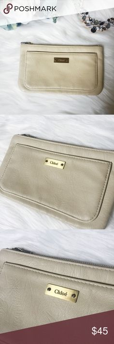 Perfect Chloe Cream Colored Wallet W/ Two Pockets Perfect Chloe Cream Colored Wallet W/ Two Pockets. Perfect condition. Magnet keeps the front pocket shut. Happy to answer any questions! Thanks for looking!   OFFERS are welcome!  ** 15% off Bundles of 3+ ** Smoke free home. No trades. Chloe Bags Wallets