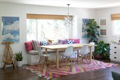 Amber Interior Design, Amber Lewis, kilim, rattan chairs, ikat pillows, built in dining area, mixed chairs, fig tree, star pendant, campaign dresser, bamboo roman shades