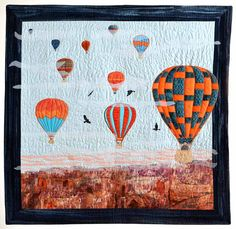 """Up, Up and Away"" by Charlene Cinpinski.  Milwaukee Art Quilters.  Hot air balloons over the desert"
