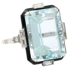 Art Deco Aquamarine Diamond and enamel Ring | From a unique collection of antique and modern miscellaneous jewelry at https://www.1stdibs.com/furniture/more-furniture-collectibles/miscellaneous-jewelry/