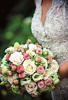 Ultra Romantic Bride's Bouquet Showcasing: Creamy Peach Roses, White Lisianthus, Pink Spray Roses, Greenery