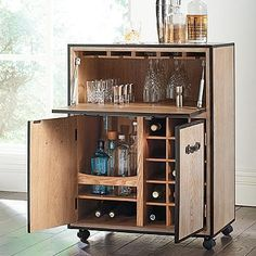 Galway Mobile Bar Cart, Grandin Road - cute idea for keeping Lauren and Kevin's favorite bourbons close but can close up and keep out of the way too. Maybe not this exact one, not in love with the colors.