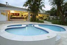 Resultado de imagem para área de lazer com piscina e churrasqueira rústica