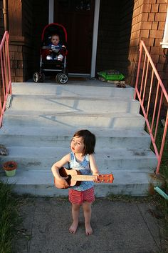 Ukulele Girl.  this is Da Ninj serenating Lil' Auggs...who can be seen in the background.  @michellejammes