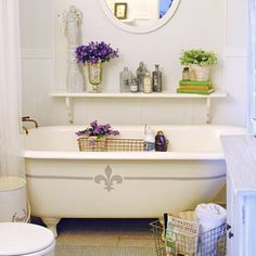 The French Style Farmhouse Bathroom uses wire baskets for organization and flowers and vintage bottles for pretty vignettes.