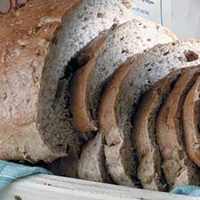 Wheat bread with pecans that can be made by hand or in a bread machine.