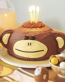 An animal theme can really get things swinging at a kids birthday party. Indulge your childs penchant for monkey business with a fanciful banana cake with chocolate buttercream icing shaped and decorated to look like a curious friend.