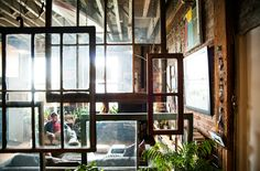 windows on chains - love this for visual division of space. Smarter Alec: Hey, Dumbo! An Artists Loft For Me!