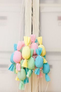 Egg Poppers – Turn your Easter egg hunt into a pull-and-pop party. Hang these candy-filled, candy-shaped poppers from a tree, give each child a color and let them to go to town. Click through to view the whole gallery and more easter egg hunt ideas.