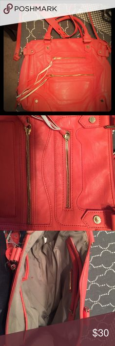 Steve Madden coral colored purse Steve Madden coral colored purse with gold accents 2 zippered front pockets and 1 zippered pocket inside. Steve Madden Bags Crossbody Bags