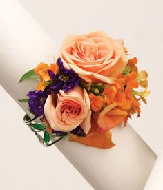 "Florist Express. Item Description:  A beautiful corsage to compliment any dress, roses, rose petals, alstroemeria, kalanchoe and larkspur are thoughtfully arranged on a reusable bracket.  Measures 5""H x 3.5W x 3""D."