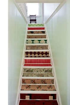 100 years of colourful flooring material taken up from the kitchen of Thomas Mouland House in Newfoundland. Repurposed scraps created this gorgeous staircase by Cape Race Cultural Adventures.