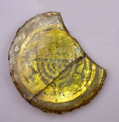 A fourth-century gold-glass base from the Jewish catacombs of Rome is a vessel base turned tomb-marker depicts a Torah Ark and certain Jewish symbols: the menorah (the seven-branched candlestick), lulav (palm branch), etrog (citron) and shofar (ram's horn). (The Israel Museum, Jerusalem)