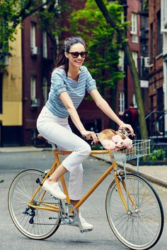 """I'm always asked what the perfect outfit for riding a bike is, and I always have the same answer: one that looks good on and off your bicycle. This look is playful and cute, plus the striped top makes me feel like I'm riding my bicycle on the Italian coast."" See more at jcrew.com/blog."