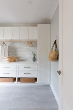 A well designed laundry has a space for everything. Marble subway tiles, white shaker cabinetry, baskets for shoes and hanging space for clothes to dry. Built by Realm Building. Mudroom Laundry Room, Laundry Room Layouts, Laundry Room Organization, Laundry In Bathroom, Modern Laundry Rooms, Home Renovation, Laundry Room Inspiration, Laundry Room Design, Küchen Design