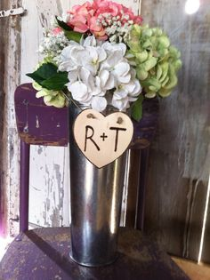 If you are looking for country wedding ideas, or if you are decorating for a themed wedding. This vase is complete with a customizable heart. See more info here https://www.etsy.com/listing/150259900/wedding-centerpiecepersonalized-vase?utm_source=OpenGraph_medium=PageTools_campaign=Share