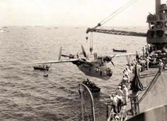 PBM-3D Mariner aircraft of US Navy patrol squadron VP-216 being hoisted onto seaplane tender USS Chandeleur, Saipan, Mariana Islands, 24 Jun 1944. (US Navy photo) ~ BFD