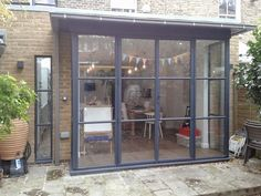 Met Therm Windows were contracted to replace the standard bi-fold doors with door screens. Metal Windows, Aluminium Windows, Windows And Doors, Corner Windows, Crittal Doors, Crittall Windows, Conservatory Kitchen, House Extension Design, Glass Installation