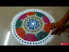 Small Easy Rangoli Design Using Mosqiuto coil - Small Easy Kolam Design Latest Rangoli Design For diwali and Laxmi puja. Find more latest, simple and beautif. Easy Rangoli Designs Diwali, Small Rangoli, Rangoli Ideas, Rangoli Designs With Dots, Diwali Rangoli, Flower Rangoli, Beautiful Rangoli Designs, Kolam Designs, Rangoli Colours