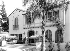 """Front entrance of the Garden of Allah Hotel. In 1919, actress Allah Nazimova bought a large mansion at 8152 Sunset Blvd. called """"Hayvenhurst,"""" & then spent $65,000 remodeling both the interior & exterior, building a pool & landscaping the property's three and a half acres. She named it The Garden of Alla and it became a popular gathering spot where the Hollywood intelligentsia would flock for Nazimova's artistic salons. It also attracted a largely lesbian following making it somewhat…"""