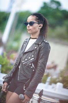 WHO: Zoe Kravitz WORE: A leather jacket, white t-shirt, black shorts, and cat eye sunnies