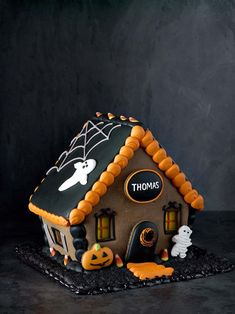 Halloween Gingerbread House | Conjure the Halloween spirit with our spooky haunted house, complete with resident ghosts. Artisan bakers at Monaco Baking Co. in Southern California prepare the gingerbread from scratch according to a classic recipe, with custom molds for a perfect fit.