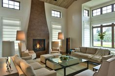 Thayer Coggin Laura Lounge Chairs, Cosmopolitan Ottomans, Studio MB Sofas, and Nolita Armless Lounge Chairs in Napa Valley Home. Courtesy of Matthew Craig Interior Design.