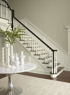 Wall color is Benjamin Moore Tapestry Beige/  Molding is Ben Moore Simply White.
