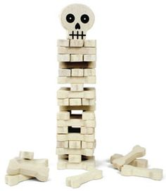 stack-the-bones game - a tickle-your-funny-bone game of balance and skull, er, skill. you build the tower, then take turns removing bones without letting it...topple!