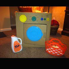 Pretend washing machine from cardboard box