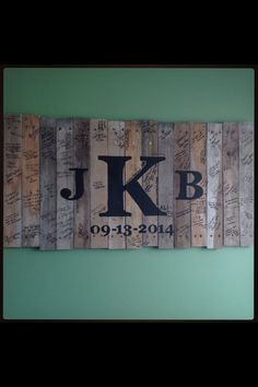 My husband made a sign out of pallet wood and painted our monogram and wedding date on it. For our unity ceremony we nailed the three middle planks in to complete the K. Then we took the sign to our reception and had guest sign it for our guest book.: